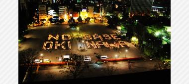沖縄に基地はいらない キャンドルで人文字アクションを行いました