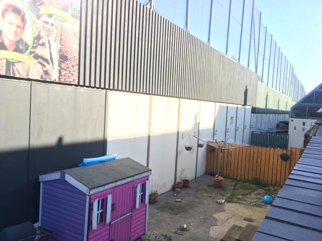 Photo - Backyward and wall