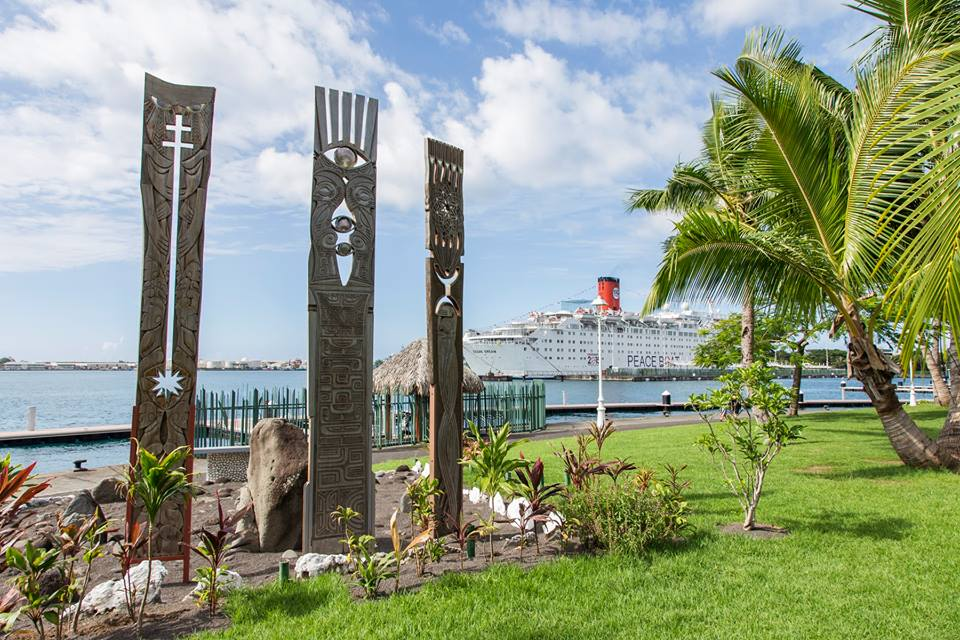 Peace Boat docks by the Moruroa e Tatou memorial site in Tahiti
